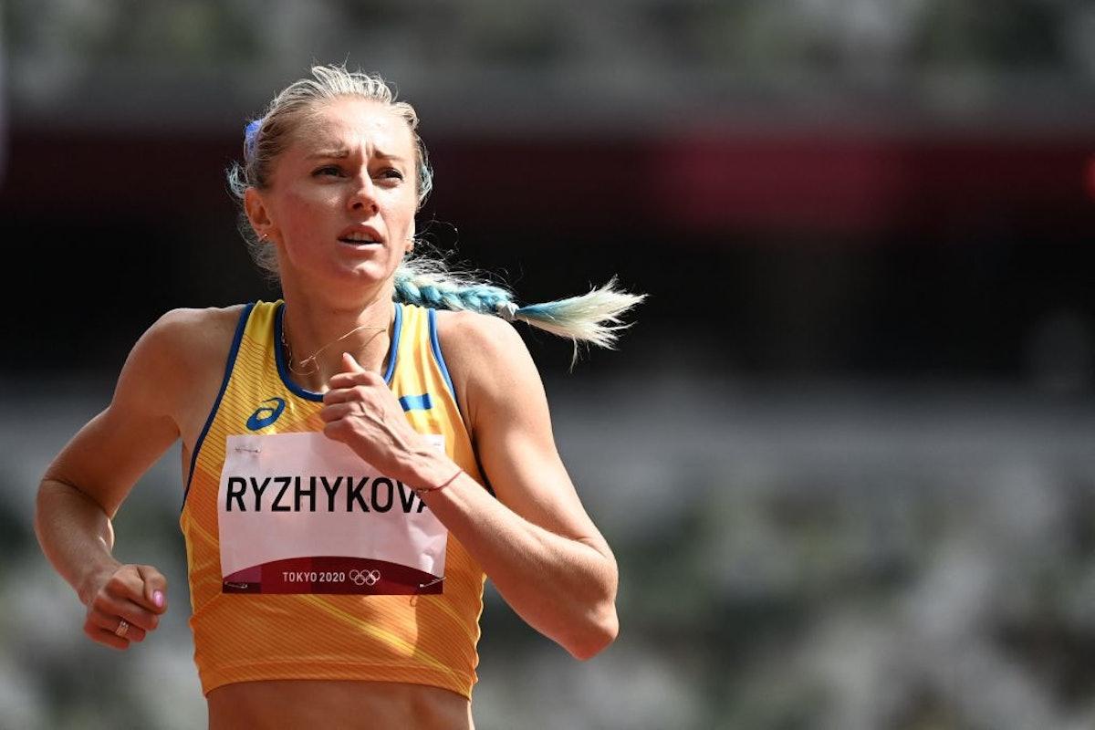 Anna Ryzhykova rocks a half-blonde, half-blue braid during the 400m hurdle competition.
