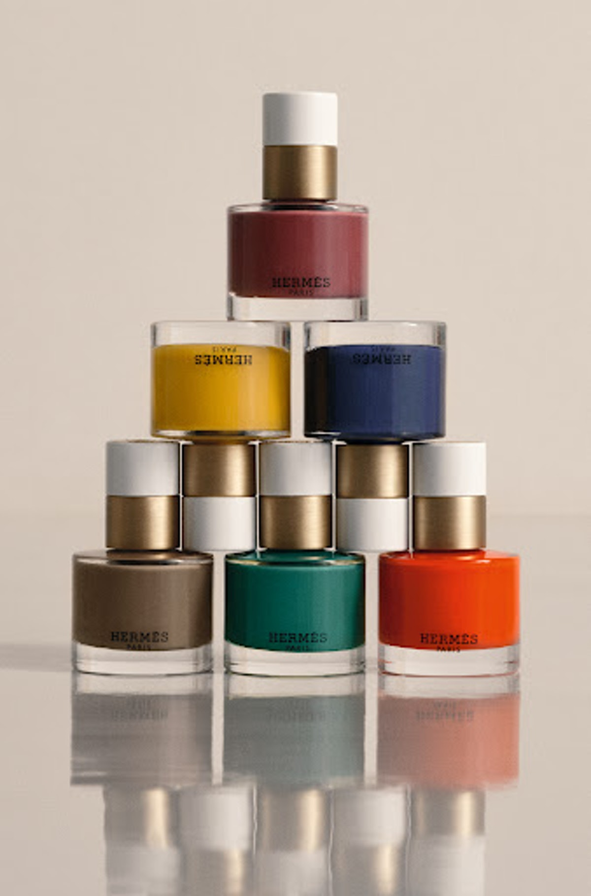 Hermès Beauty nail polished stacked in a pyramid