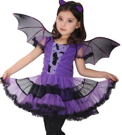 Girl dressed in a bat costume