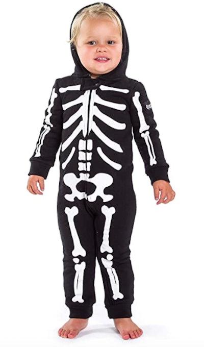 Toddler wearing skeleton Halloween costume