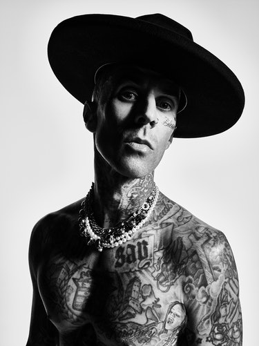 A close-up portrait of NYLON cover star Travis Barker in black and white.
