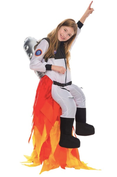 Girl wearing a flying astronaut costume