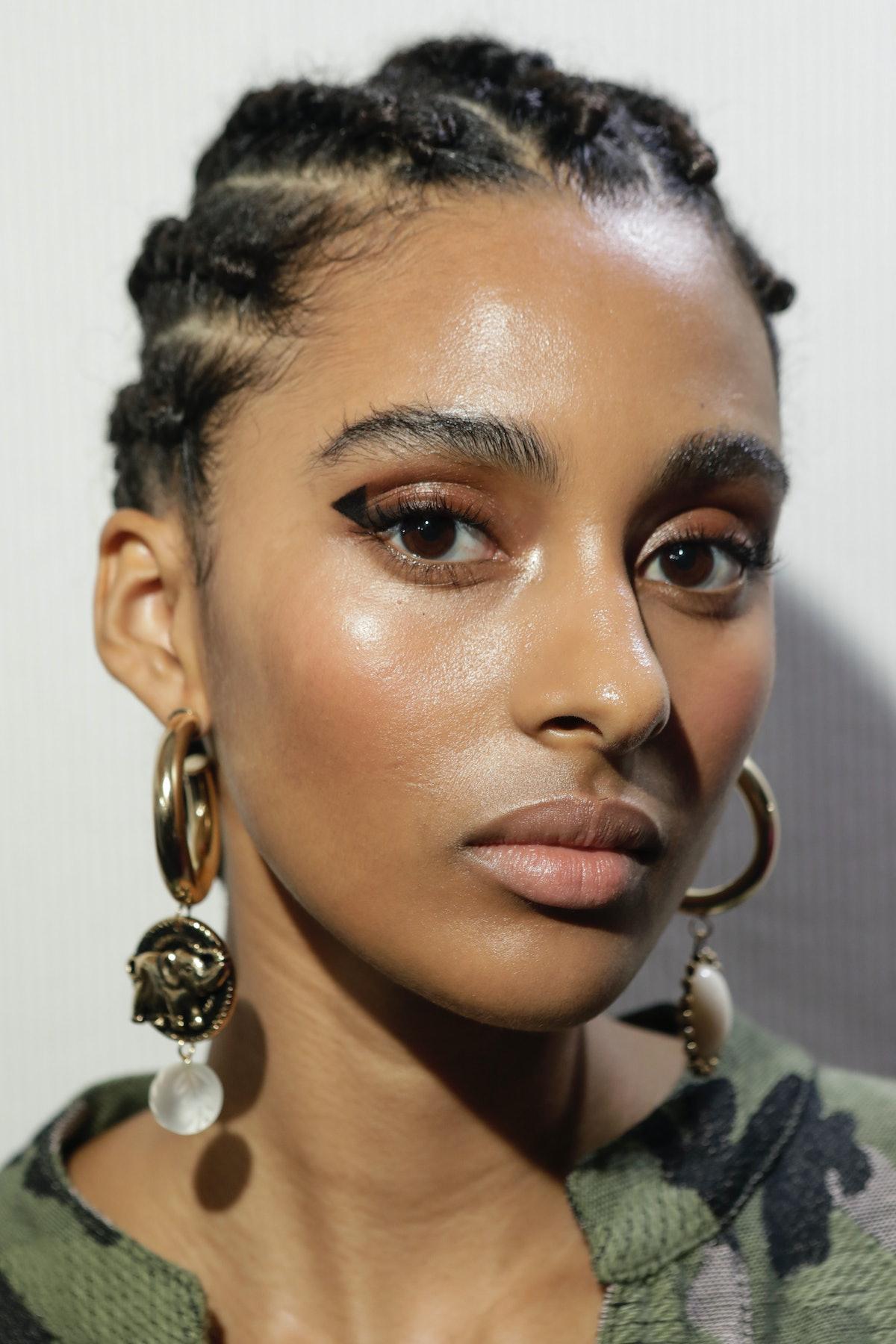 model backstage at fashion week