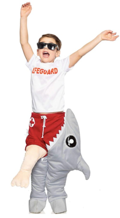 Child dressed in a shark-eating life guard costume