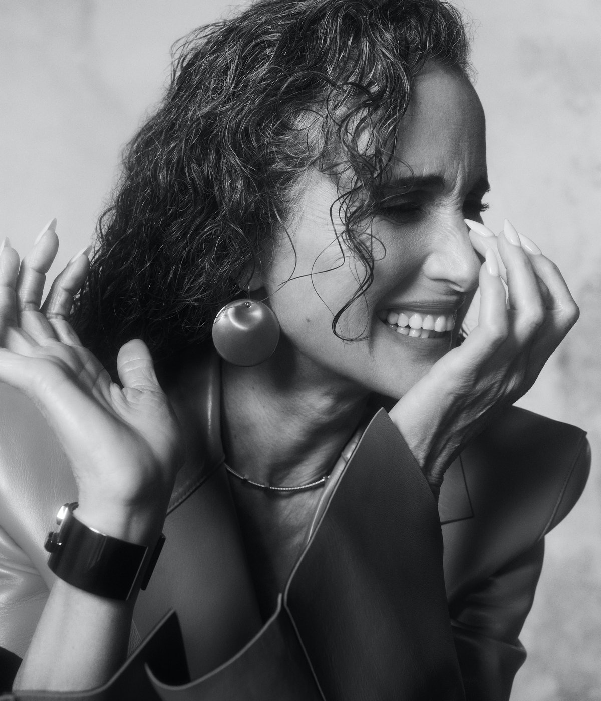 A black and white close-up shot of TZR cover-star Andie MacDowell smiling.