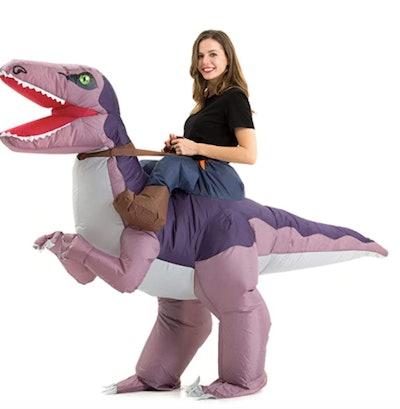 Teen wearing an inflatable dinosaur costume