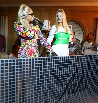 Paris Hilton and Kim Petras perform at the Saks NYFW party on September 9.