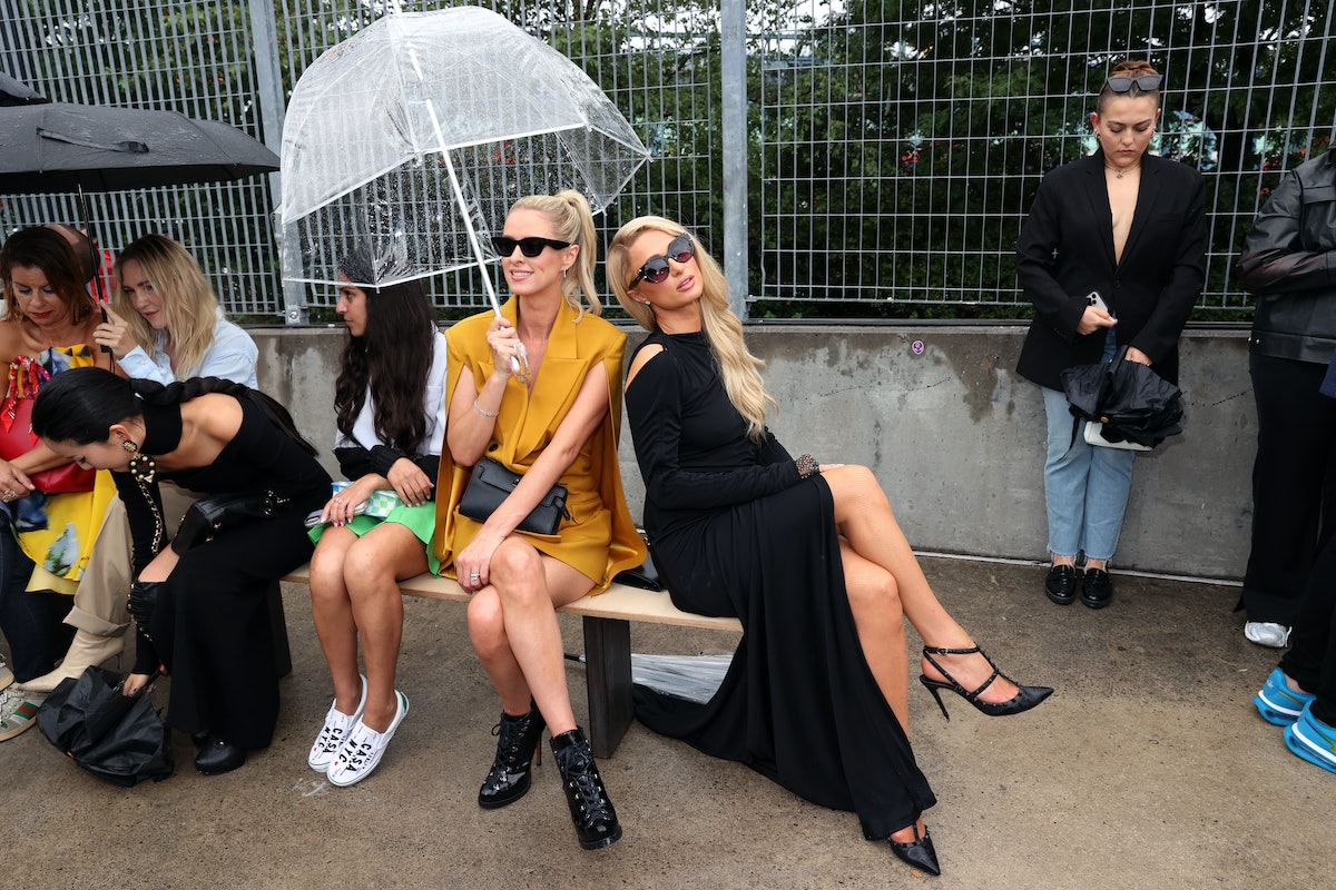 Nicky Hilton Rothschild (Center) and Paris Hilton (R) attend the front row for Monse Resort 22 durin...