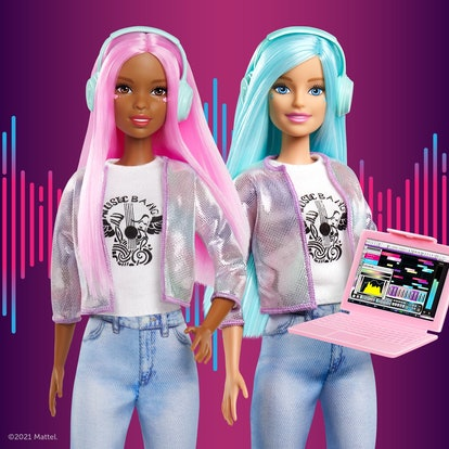 Music producer Barbies stand side-by-side with their next hit in progress on their laptop.