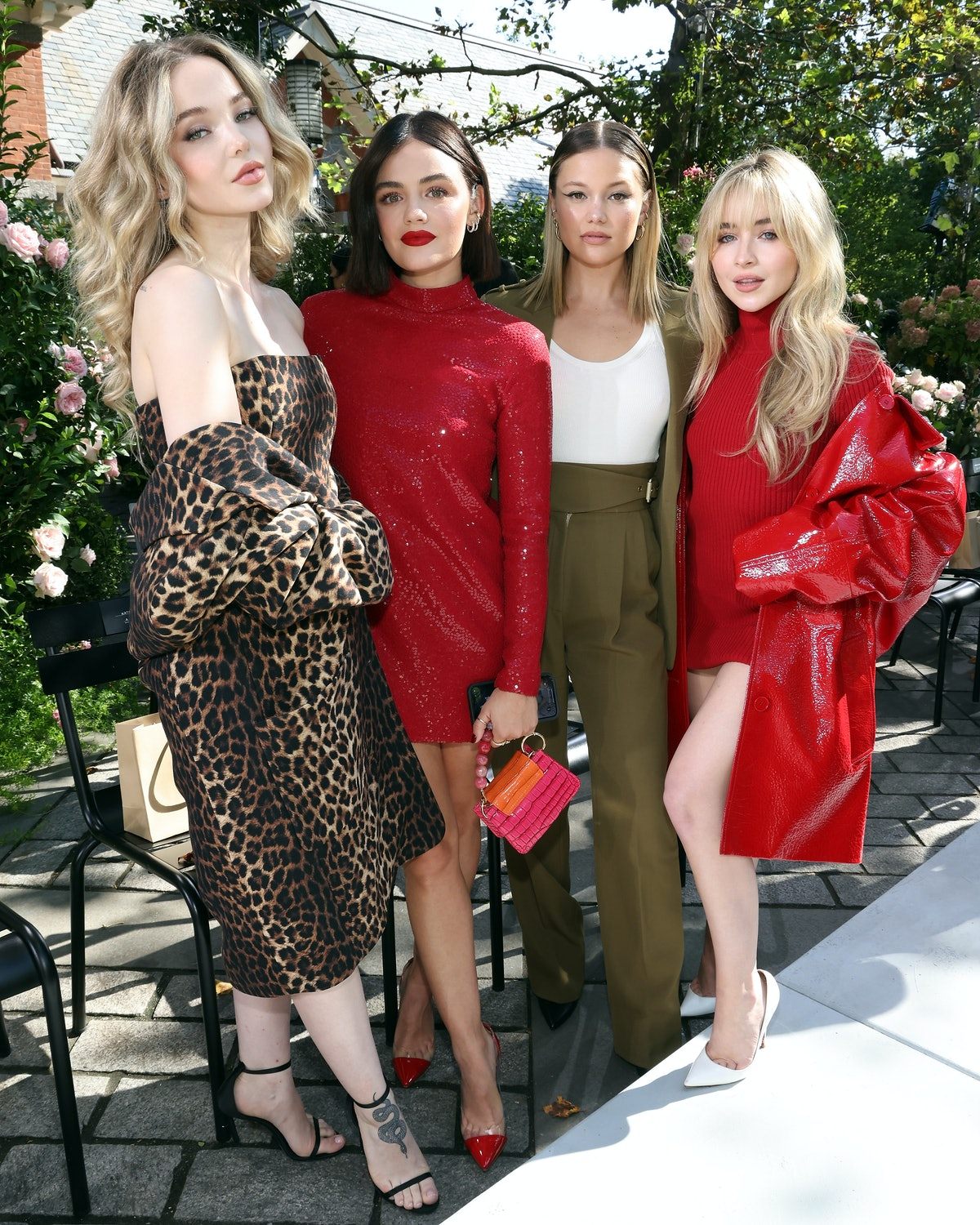 Dove Cameron, Lucy Hale, Olivia Holt, and Sabrina Carpenter attend the Michael Kors S/S 2022 show d...