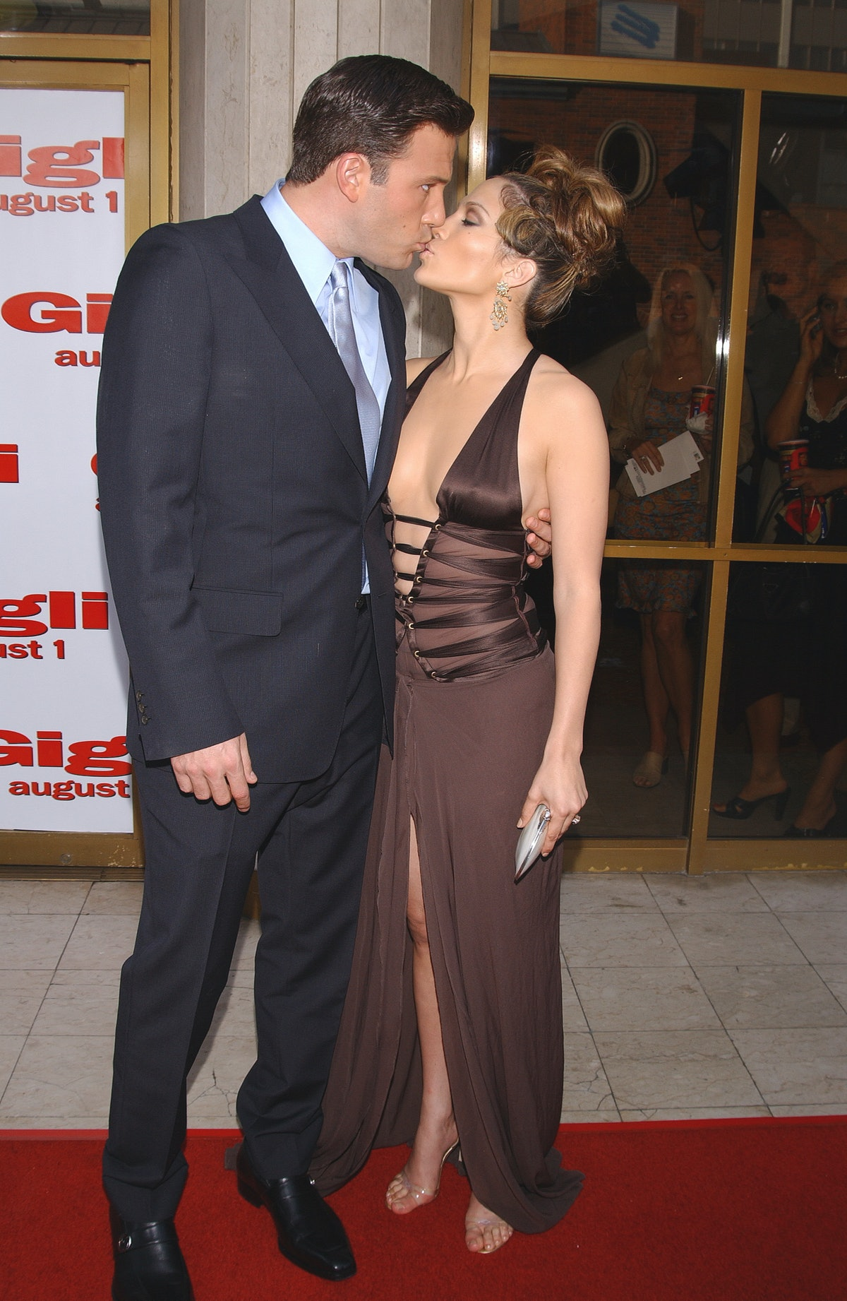 """Ben Affleck and Jennifer Lopez (dress by Gucci) arriving at the premiere of """"Gigli""""."""