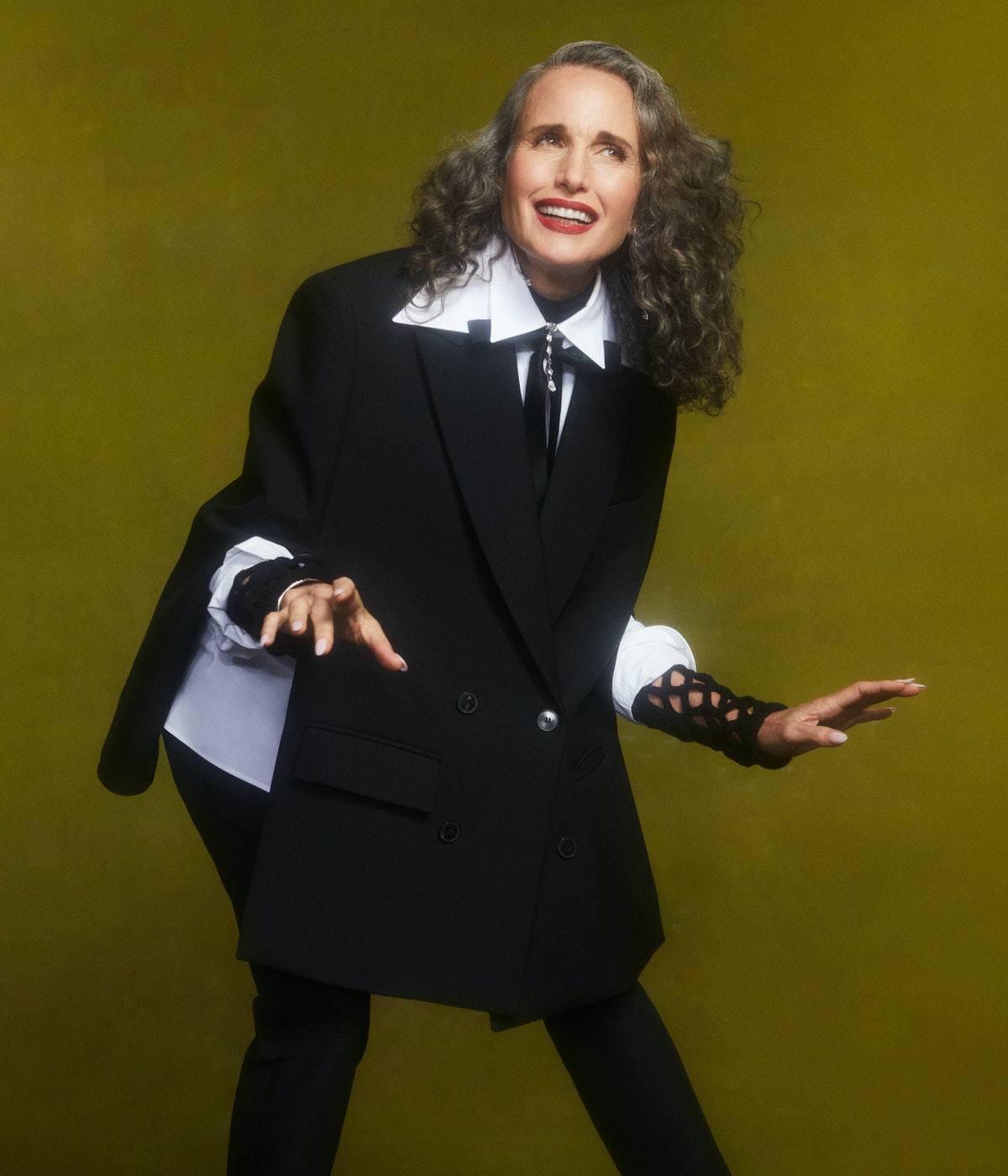 TZR cover star Andie MacDowell poses wearing a black and white Valentino outfit.