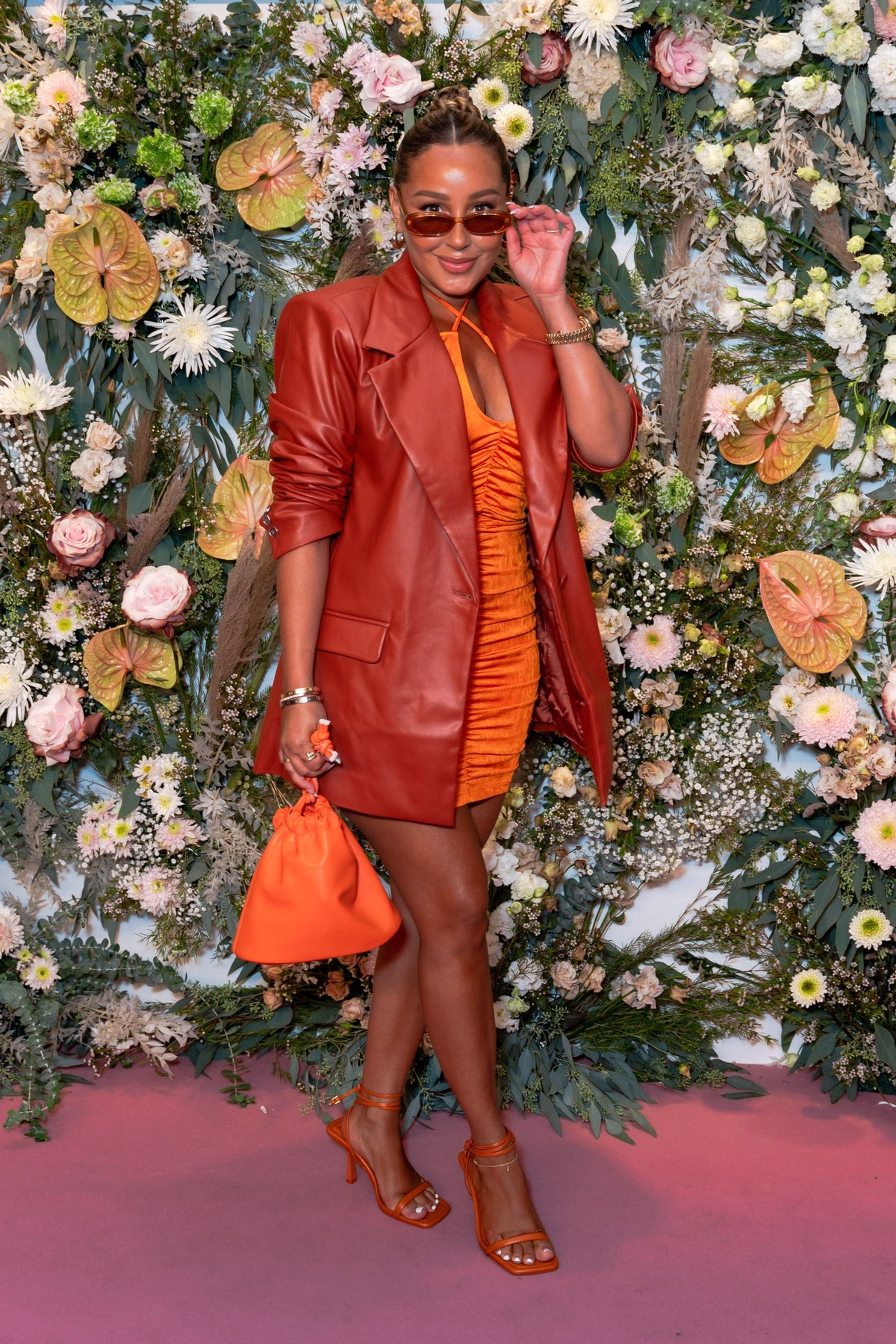 Adrienne Bailon attends the Revolve Gallery at Hudson Yards on September 09, 2021 in New York City.