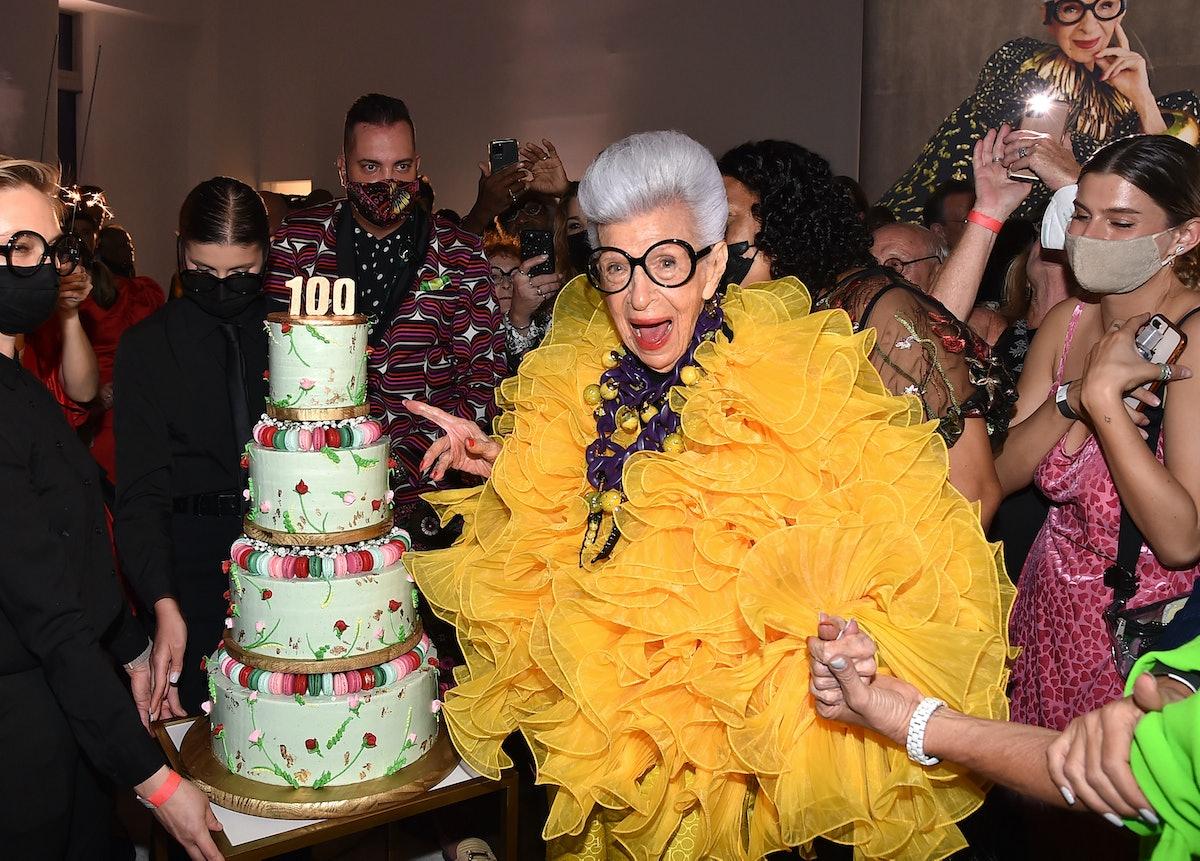 Iris Apfel celebrating her 100th birthday with a fittingly celebratory cake