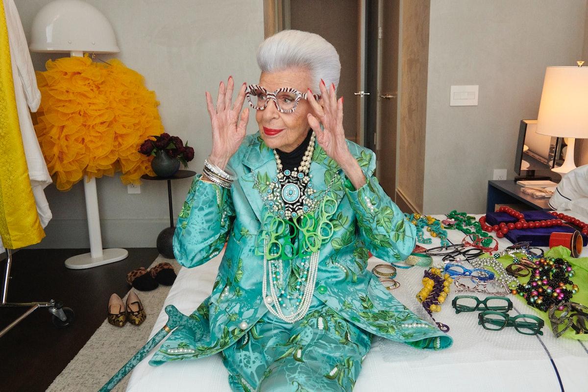 Iris Apfel touching her glasses