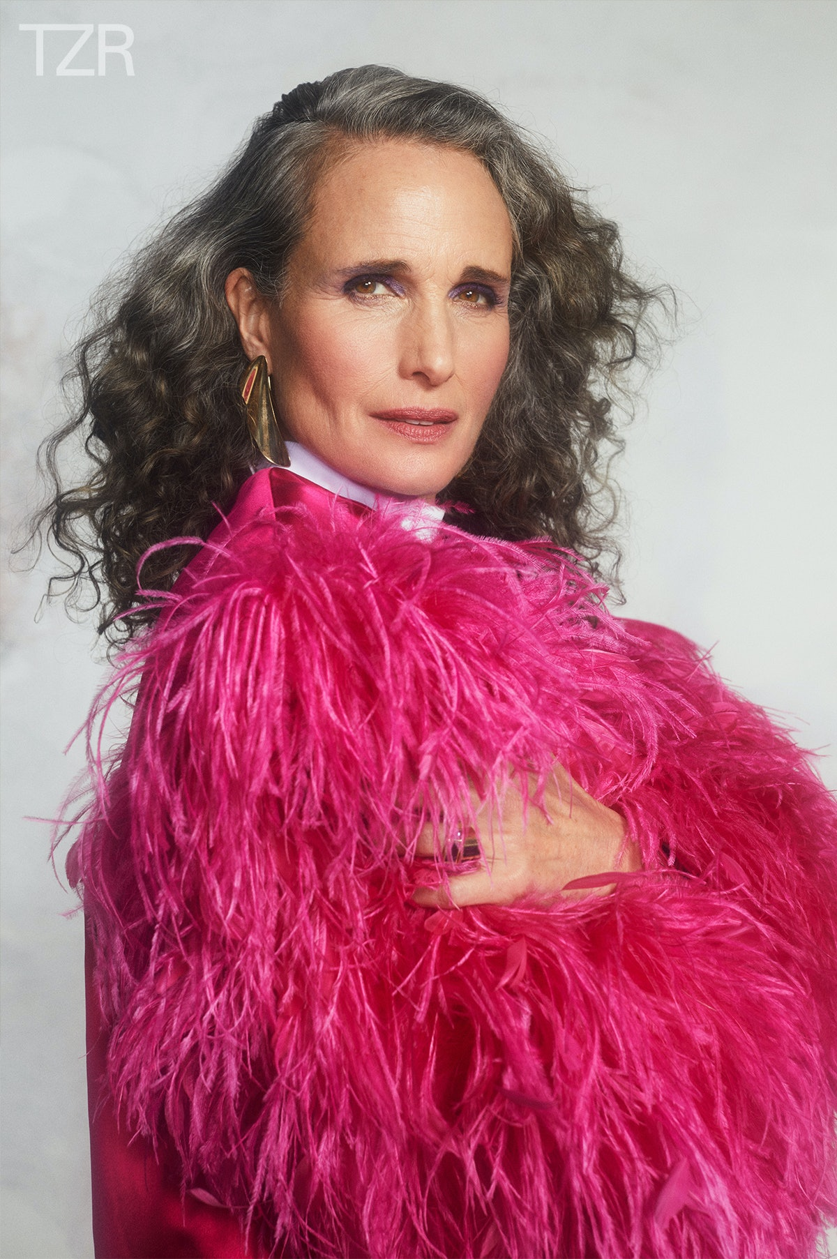 TZR cover star Andie MacDowell wears her gray hair in a voluminous side part.