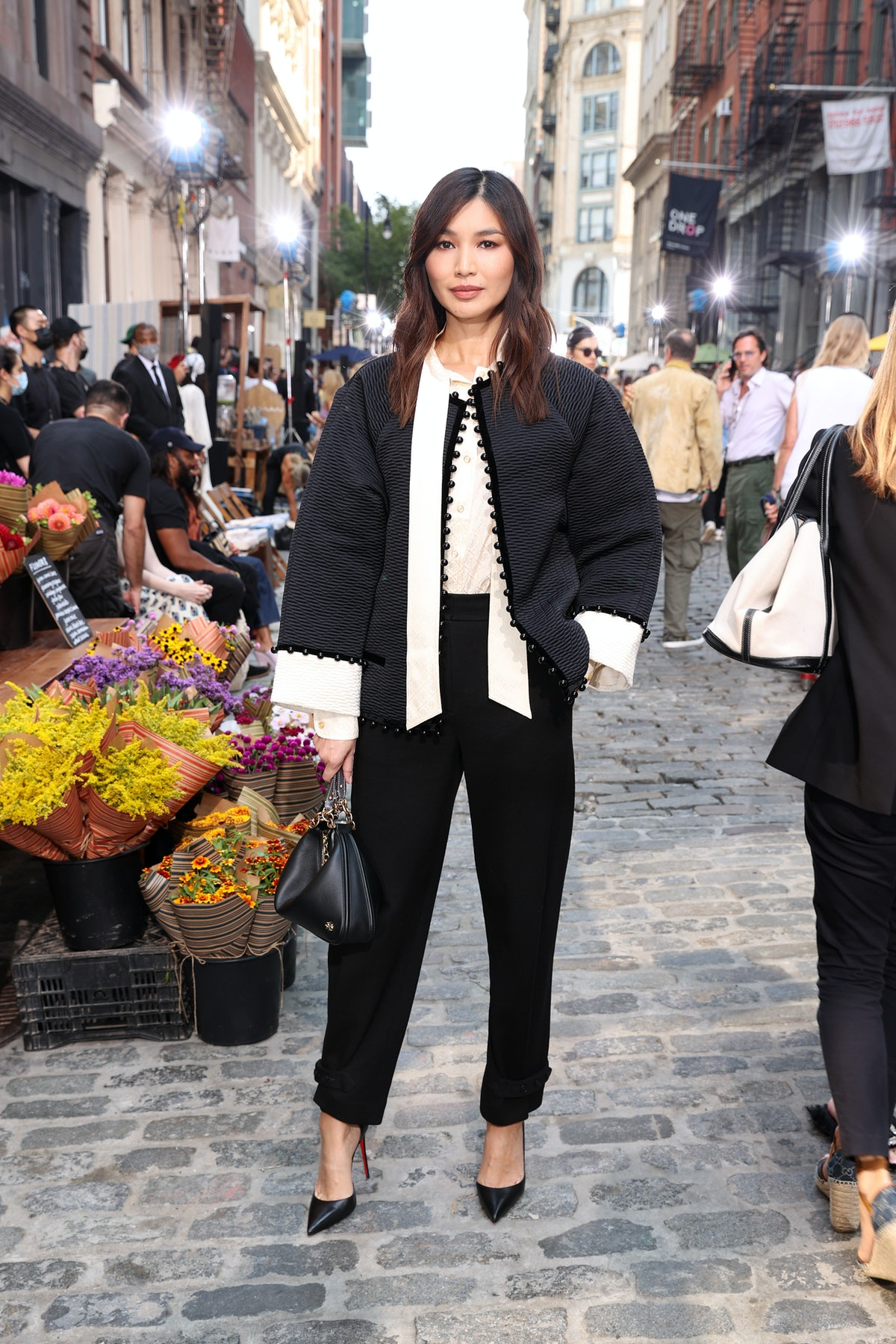Gemma Chan attends the Tory Burch Spring/Summer 2022 Collection & Mercer Street Block Party on Septe...