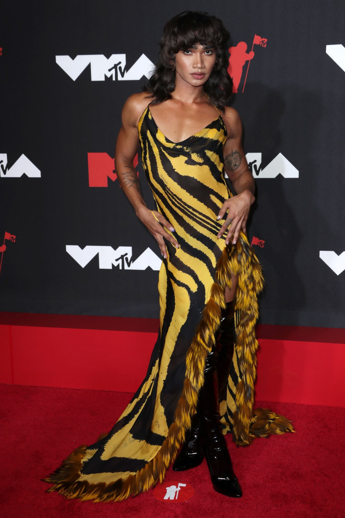 Bretman Rock at the 2021 VMAs in a yellow-and-black striped gown formerly worn by Aaliyah in 2001.