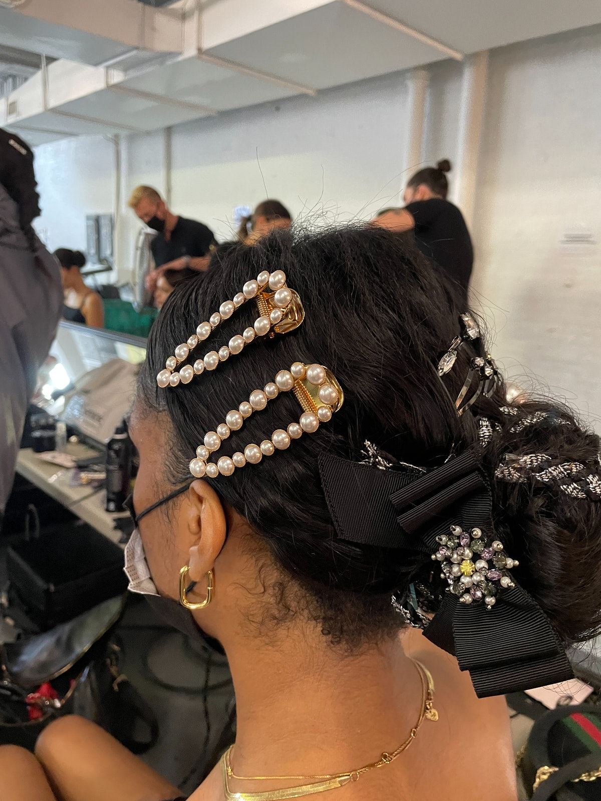 Model backstage in hair and makeup at Alice + Olivia