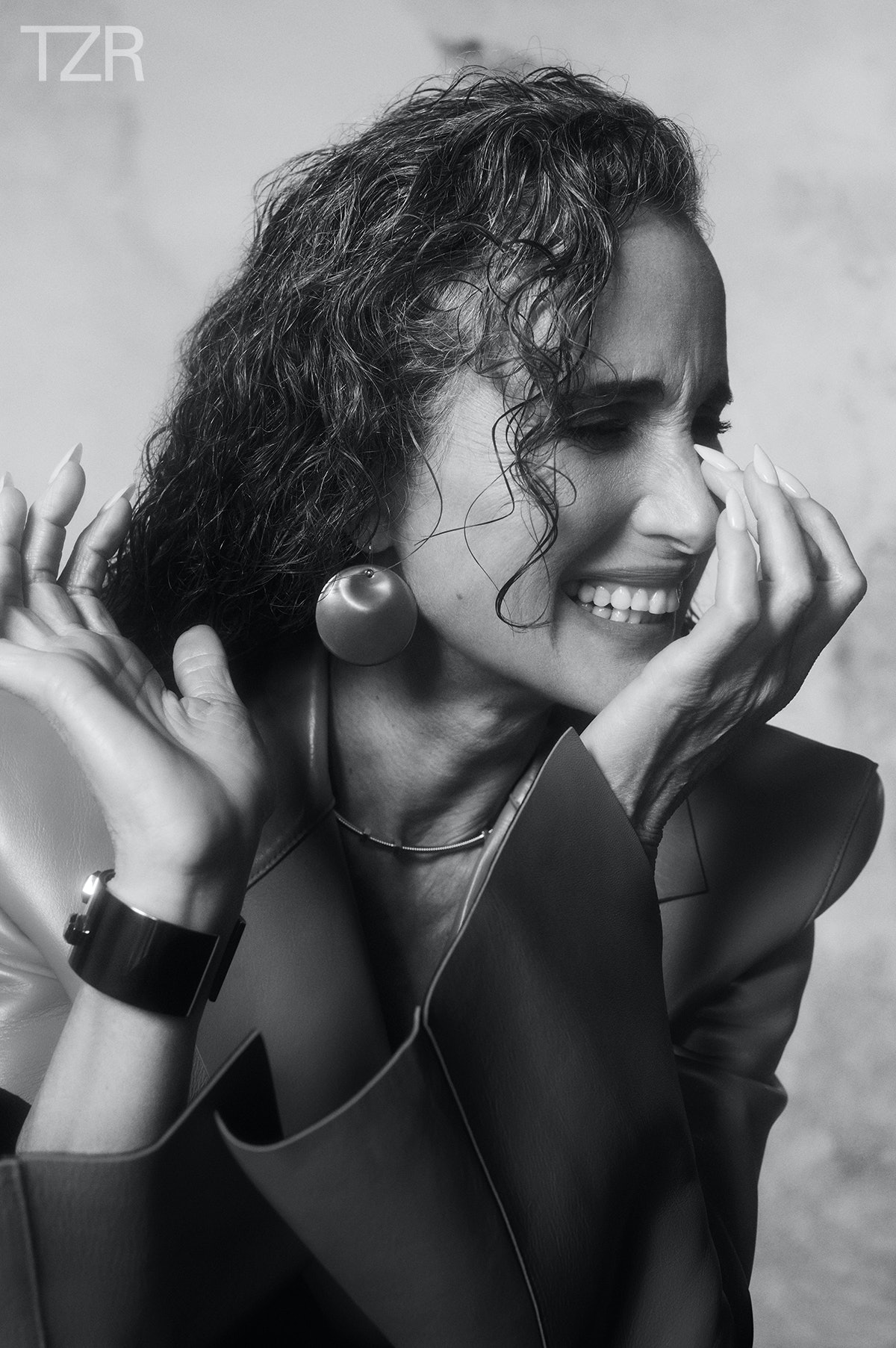 """A black and white photo of Andie MacDowell wearing her hair in """"wet"""" curls."""