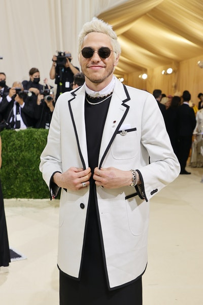 Pete Davidson at the 2021 Met Gala in a Thom Browne suit dress.