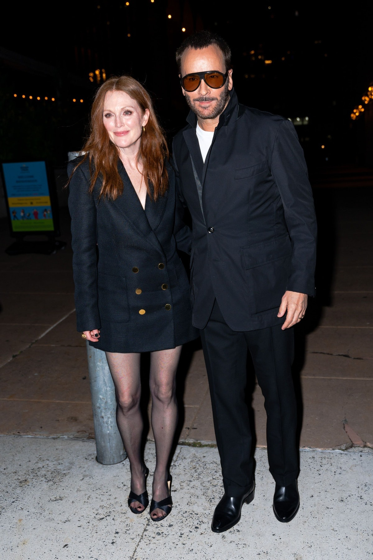 Julianne Moore (L) and Tom Ford attend the Tom Ford fashion show during New York Fashion Week at the...