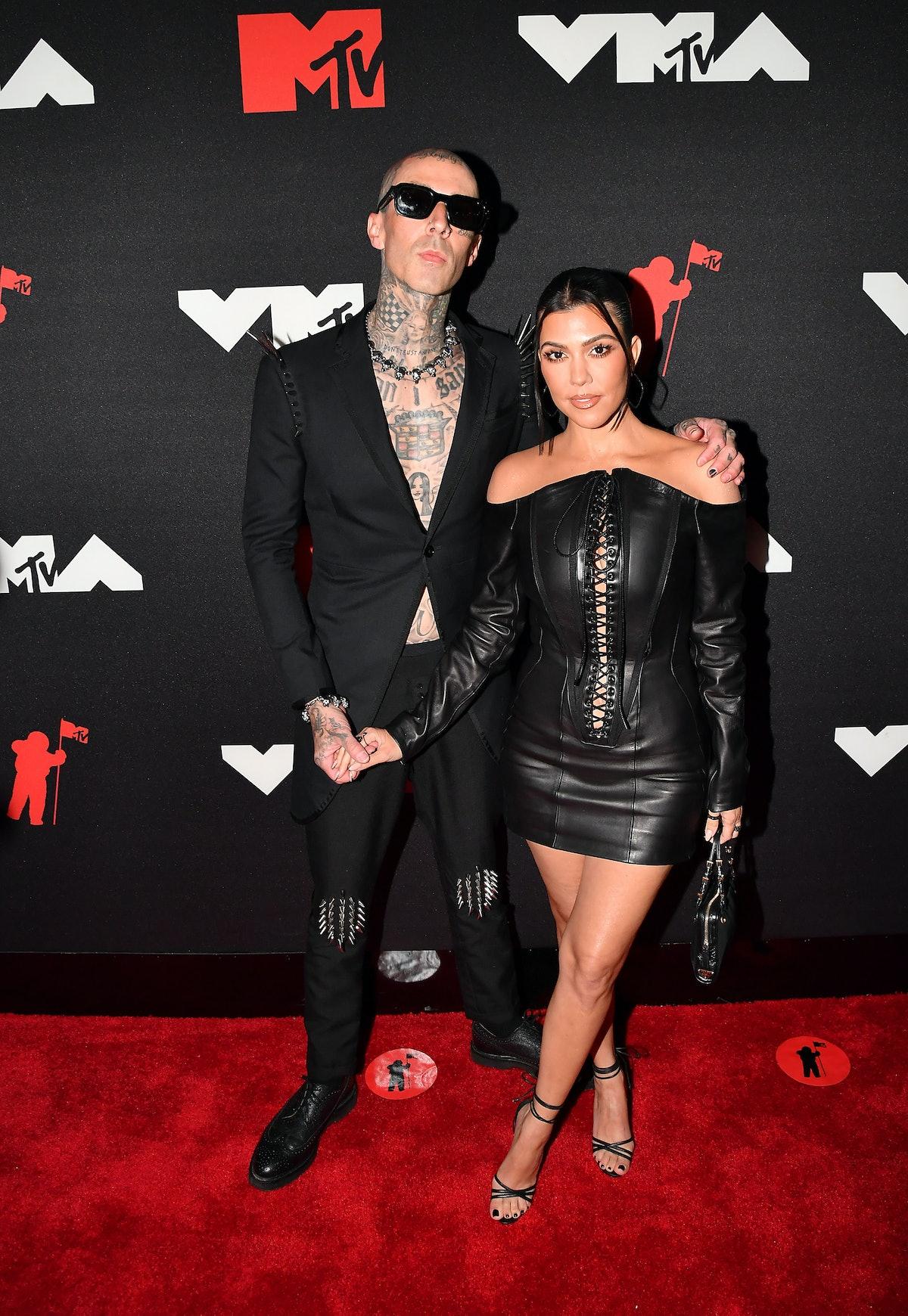 Travis Barker and Kourtney Kardashian attends the 2021 MTV Video Music Awards at Barclays Center on ...