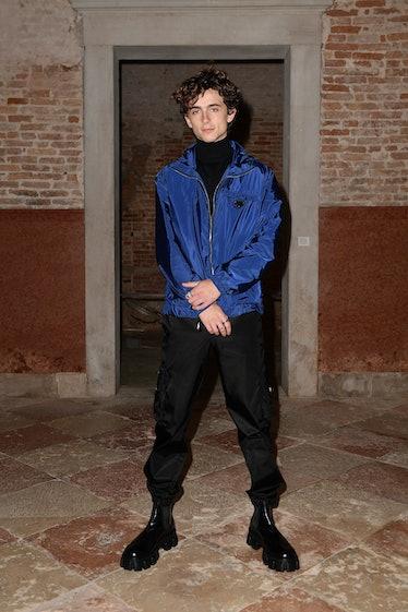 Timothee Chalamet in blue jacket.