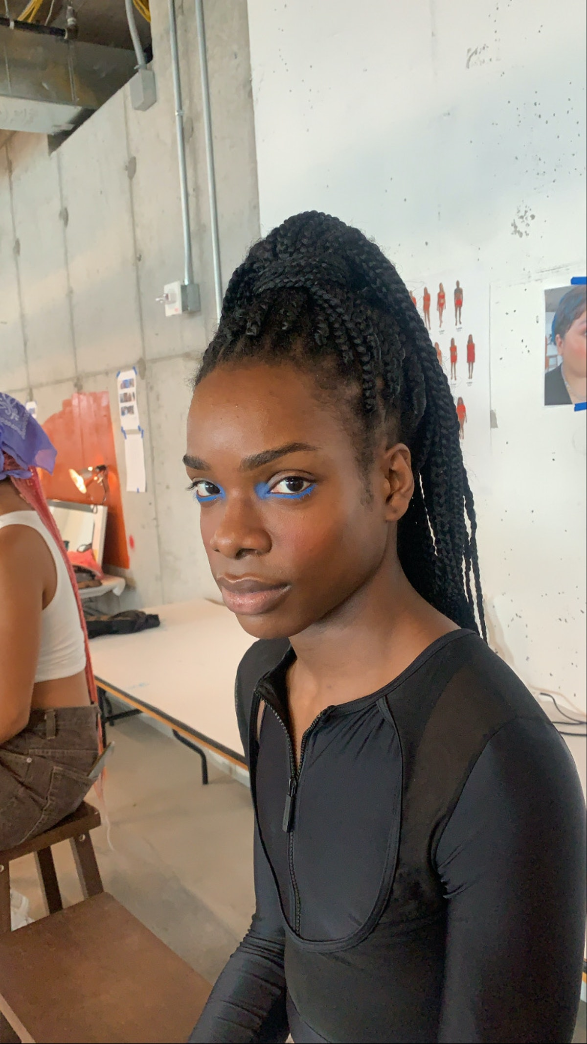 Graphic eyeliner, backstage at Chromat SS '22 show
