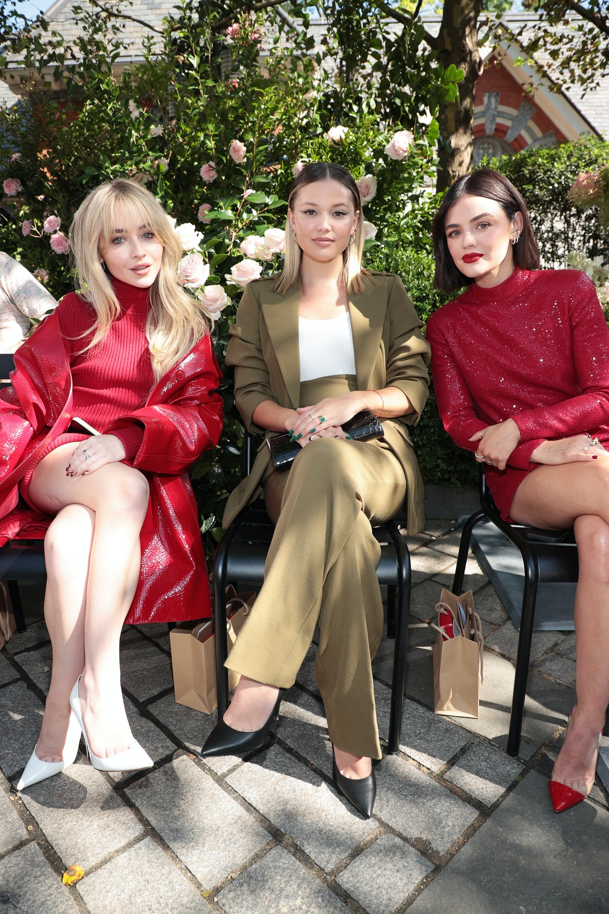 Sabrina Carpenter, Olivia Holt, and Lucy Hale sit front row at the SP22 Michael Kors Collection Runw...