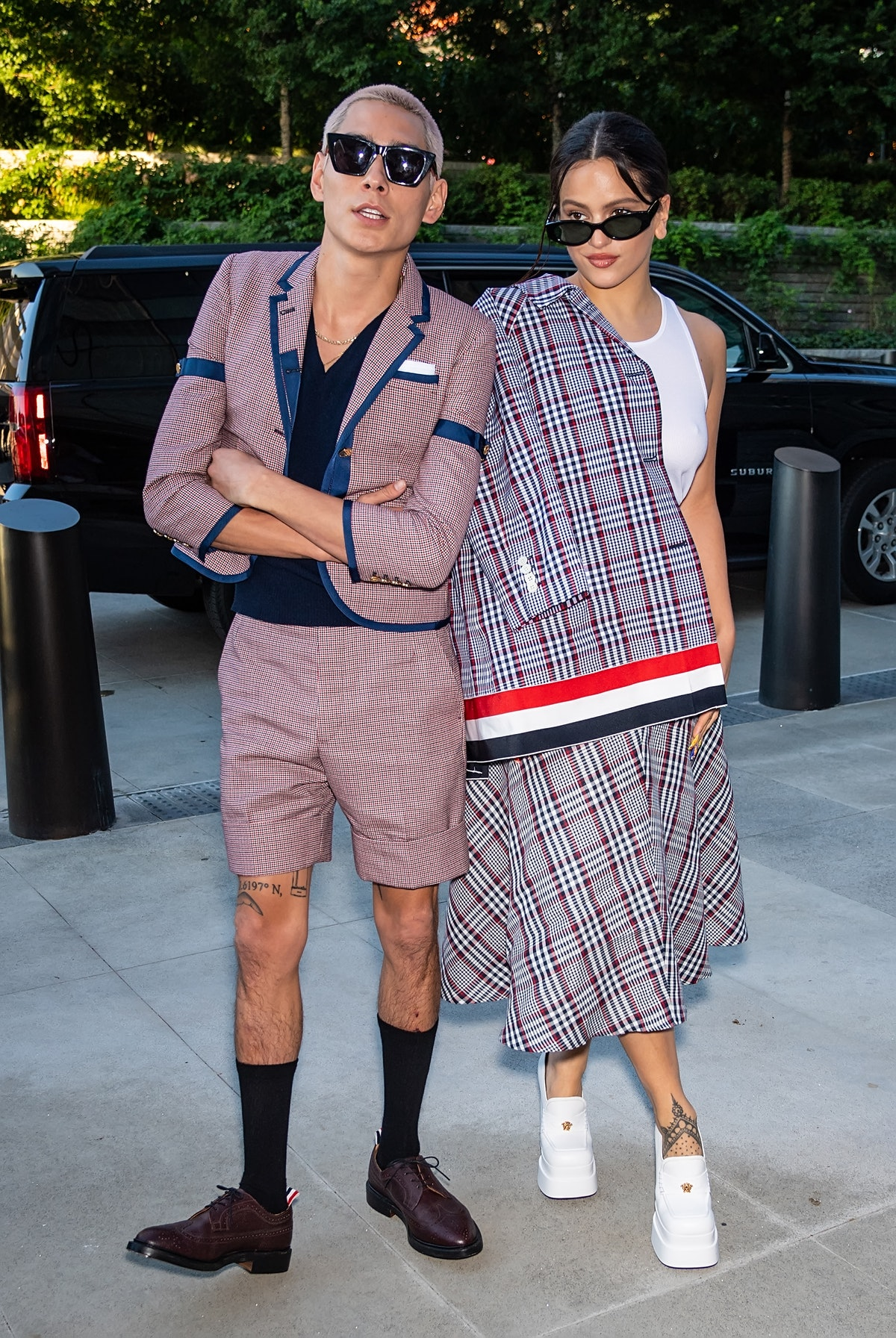 Evan Mock and Rosalía are seen arriving to the Thom Browne Spring 2022 Collection during New York F...