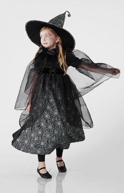 Little girl dressed up as witch for Halloween