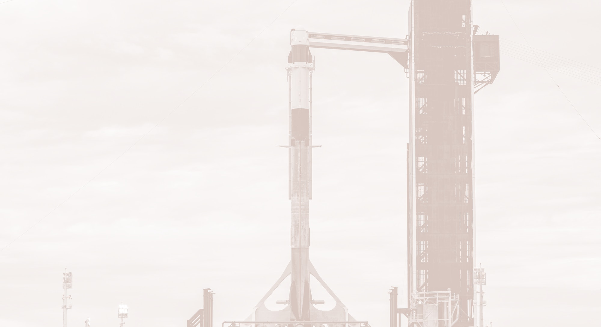 Falcon 9 rocket and Crew Dragon capsule on launchpad
