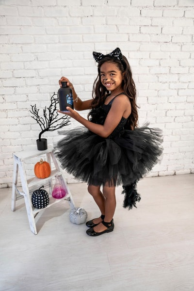 Little girl dressed up in black cat tutu costume
