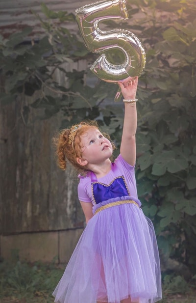 Little girl dressed in Rapunzel costume