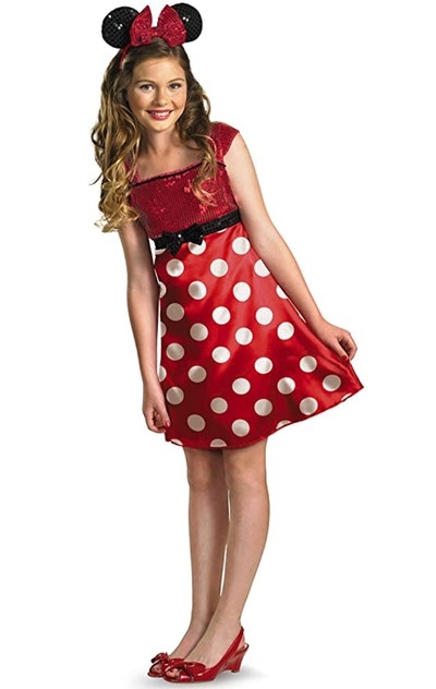 Tween girl dressed up as Minnie Mouse