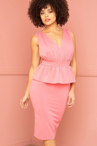 Charlotte from 'Sex and the City' would rock this peplum midi dress.