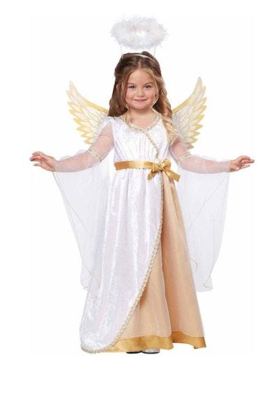 Little girl dressed in angel costume
