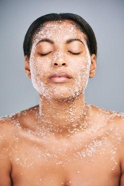 Woman using face scrub