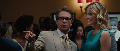 A still from 'Iron Man 2,' with Sam Rockwell (Justin Hammer) pointing during a professional event.