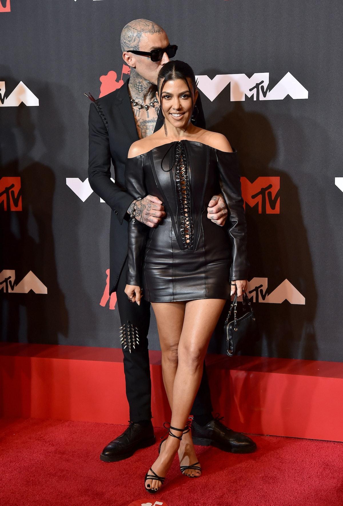 Kourtney Kardashian and Travis Barker's body language the VMAs was hot and heavy.