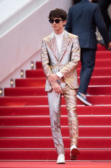 T. Chalamet in silver suit.