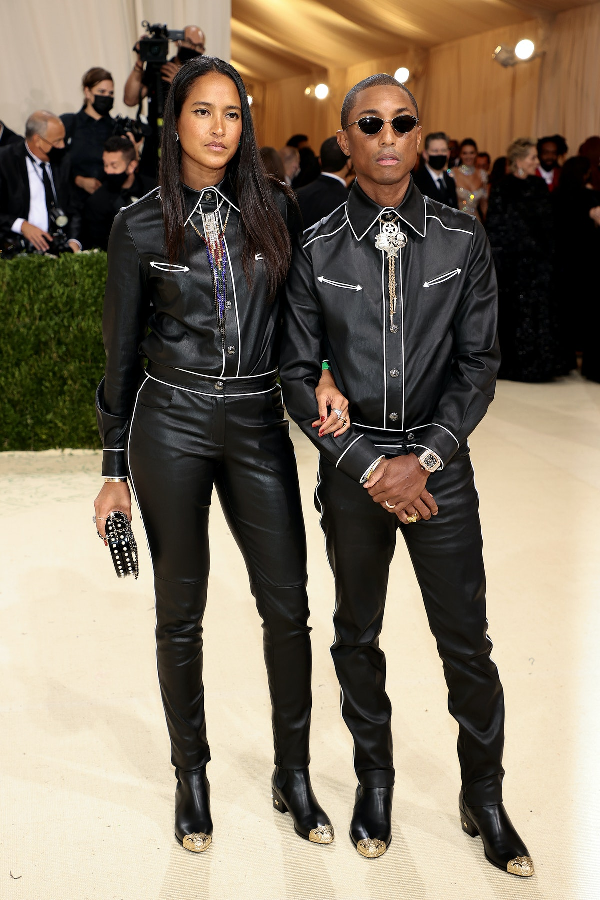Helen Lasichanh and Pharrell Williams attend The 2021 Met Gala Celebrating In America: A Lexicon Of ...