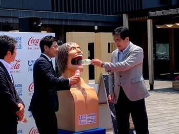Officials unveiling Attack on Titan reclycing bins in Oita