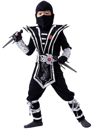 Little boy posing in ninja costume