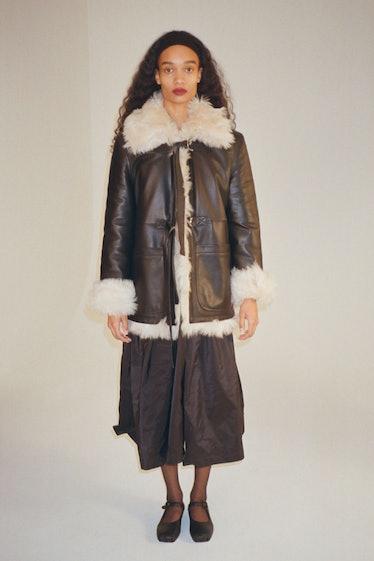 Sandy Liang fur lined coat.