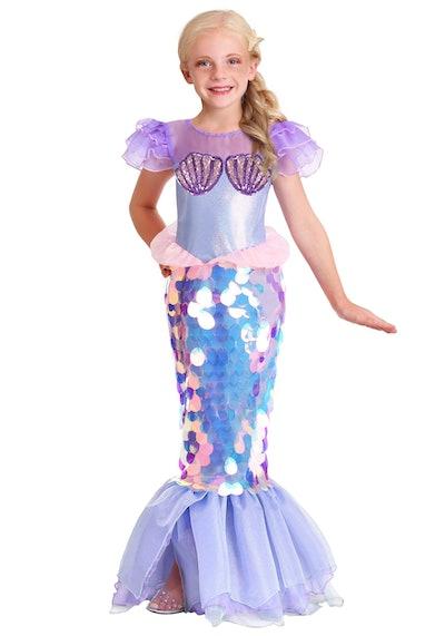 Child posing in mermaid Halloween Costume