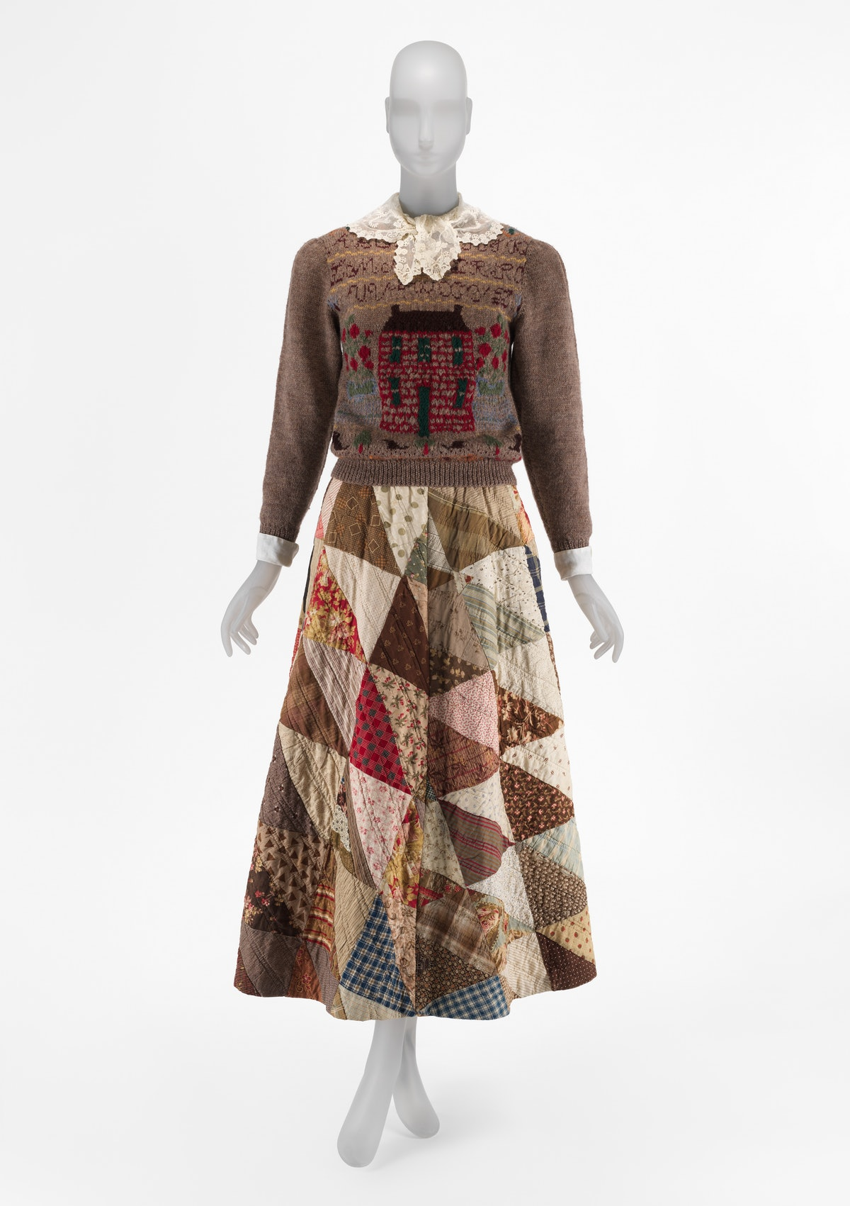 a mannequin wearing a quilted skirt and knit sweater by Ralph Lauren