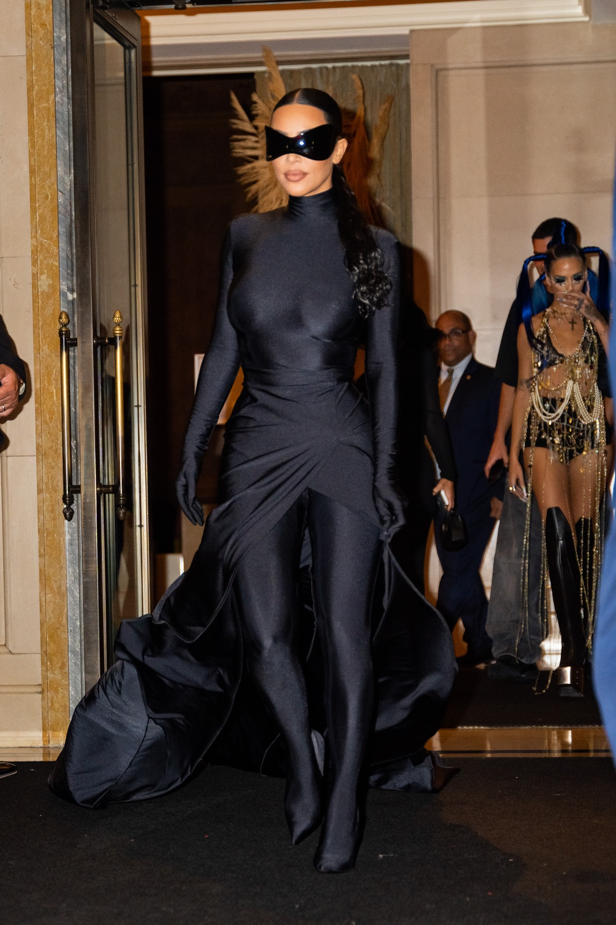 Kim Kardashian in batman glasses.