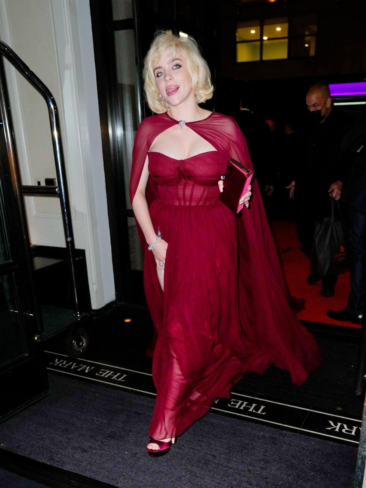 Billie Eilish in red gown.